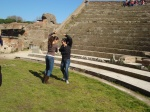 students from Spain dancing for fun at Ostia Antica while there friends made the music